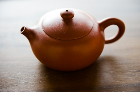 red clay: Red clay Chinese tea pot on wooden table