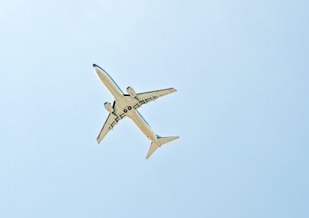 Airplane takes off over azury background photo