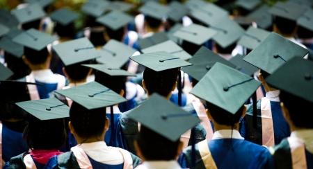 commencement: Shot of graduation caps during commencement