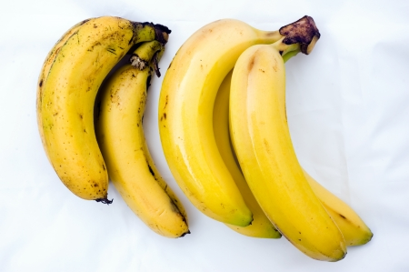 ripening: Changing the color of a group of bananas during four days  Stock Photo
