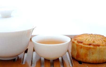 Chinese moon cakes and tea  for Chinese mid-autumn festival.  photo