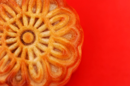 moon cake festival: a Chinese moon cake on red background. for Chinese mid-autumn festival.