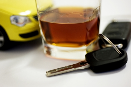 dui: Car key in a wine glass,concept of drunk driver