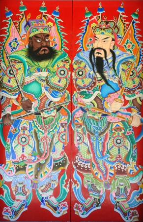 This is a very traditional kind of house gates in China, which painted the ancient generals on the two sides of the gate. They are called door gods in China.