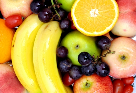 Variety of fresh natural fruits.  Wholesome food. photo