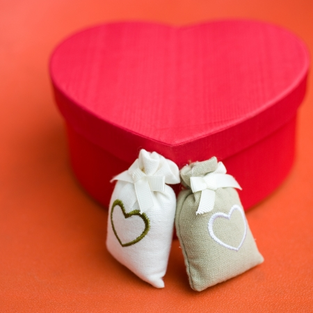 Heart shaped gift box against background.  Stock Photo - 14010718