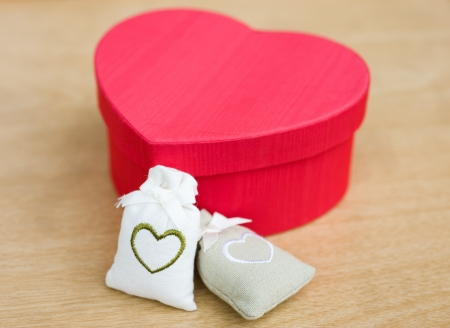Heart shaped gift box against background. Stock Photo - 14010514
