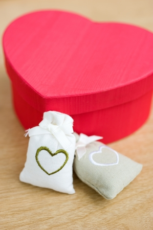 Heart shaped gift box against background.  photo