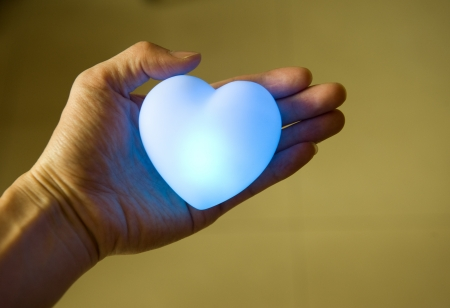 love concept. holding a heart in hands.  photo