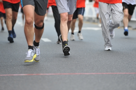 running feet of marathon racers. photo