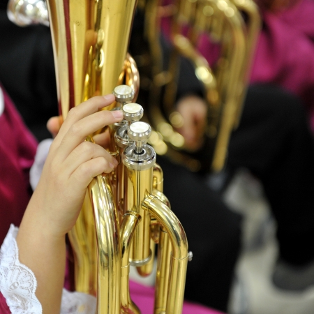 jazzy: Hands on a trumpet close up. Stock Photo