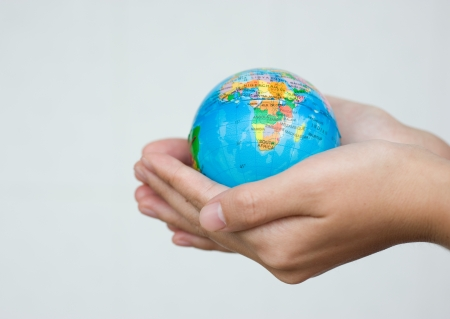 A pair of hands holding and saving the world Stock Photo - 14048388
