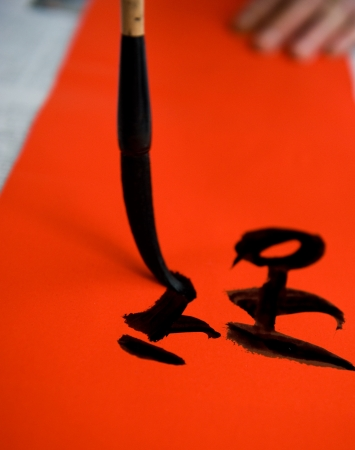 Chinese calligraphy writing a New Year scrolls. Stock Photo - 14048406
