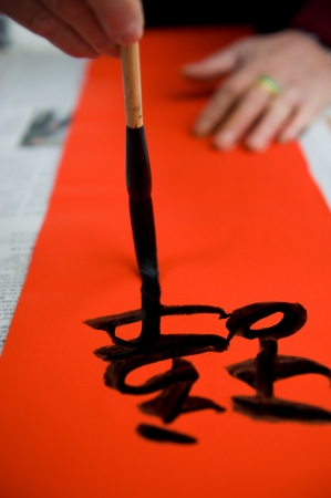 Chinese calligraphy writing a New Year scrolls. Stock Photo - 14048317