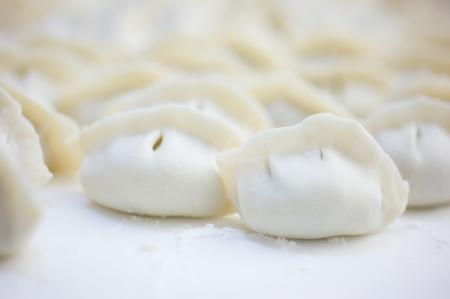 Fresh hand made Chinese dumplings.  photo