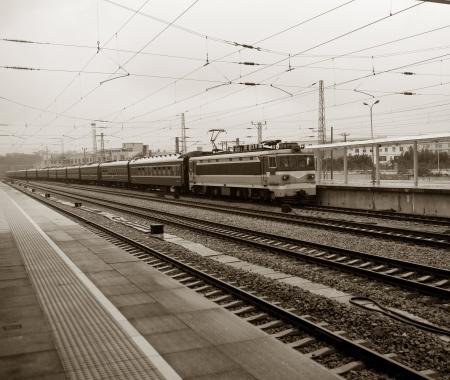 train running on railway tracks in China. photo