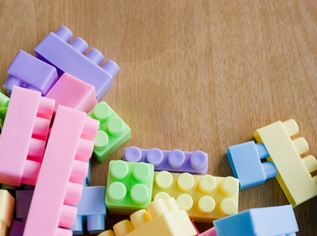 plastic building blocks on wooden table. photo