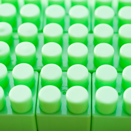 detail of green plastic construction background.  photo