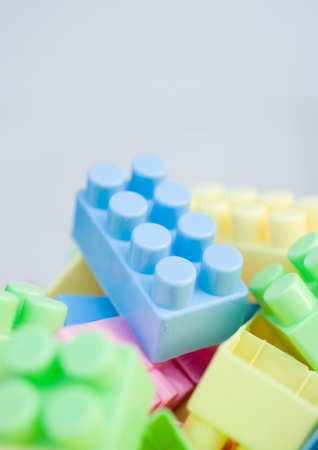 plastic building blocks on white background. photo