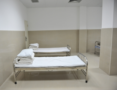 sickroom: Clean empty beds in a hospital ward.