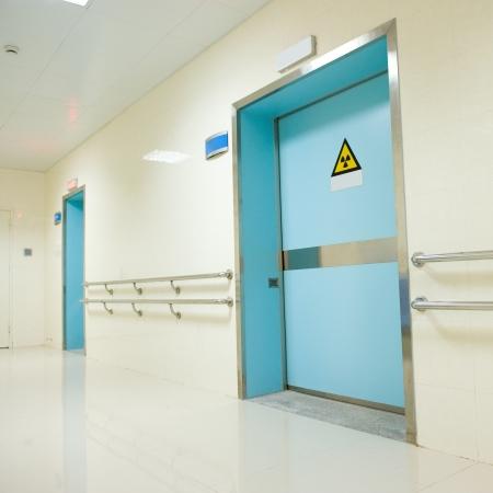 corridor in hospital with doors.