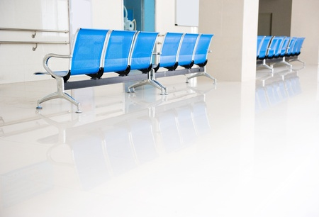 a row of chairs in the hospital hallway.  Stock Photo - 14142464