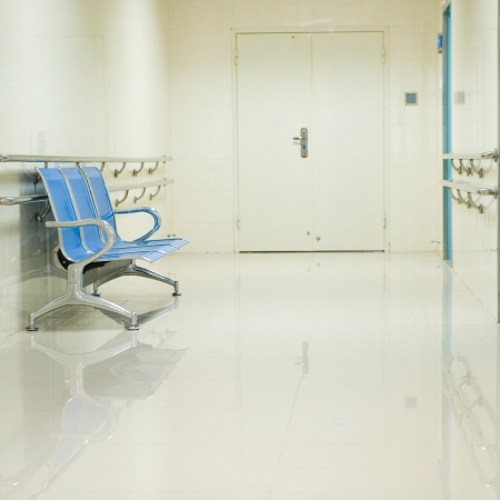 health care facility: a row of chairs in the hospital hallway.  Editorial