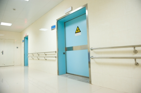 corridor in hospital with doors.