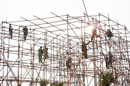 structural engineers: Construction workers working on scaffolding  Stock Photo
