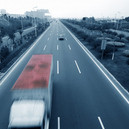 Highway with truck and cars. motion blur photo