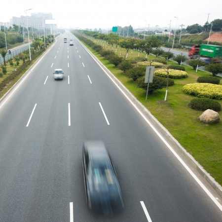 expressway: Highway with lots of cars.