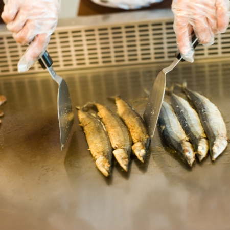Japanese chef cooking traditional saury teppanyaki on a hot plate. Stock Photo - 14053155