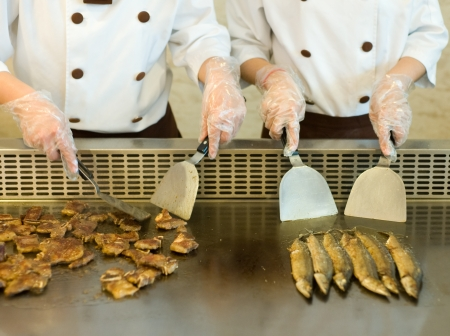 Japanese chef cooking traditional beef and saury teppanyaki on a hot plate. Stock Photo - 14053130