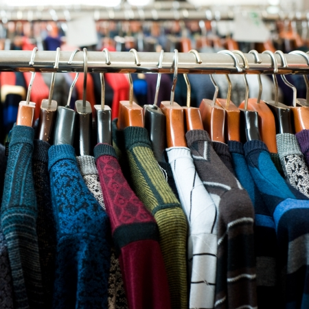 racks: colorful adult woolen clothing on sale