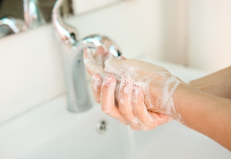 hand washing: Washing of hands with soap under running water.
