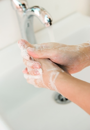 Washing of hands with soap under running water.  Stock Photo - 14078983