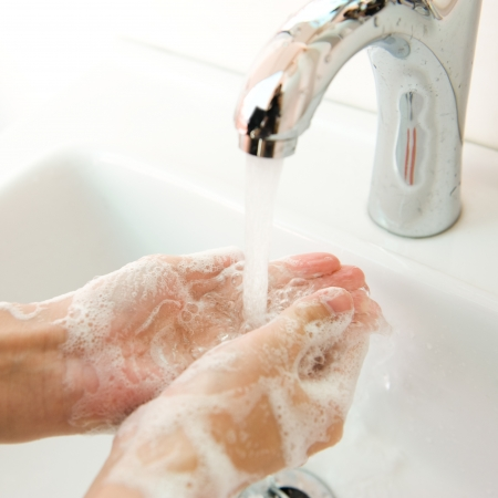 body wash: Washing of hands with soap under running water.