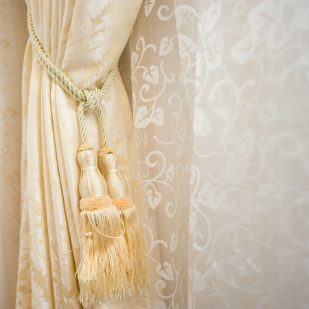 A curtain hold back by tassel Stock Photo - 14079014