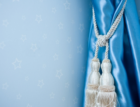 A curtain hold back by tassel Stock Photo - 14079062