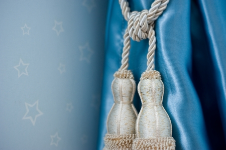 A curtain hold back by tassel Stock Photo - 14079066