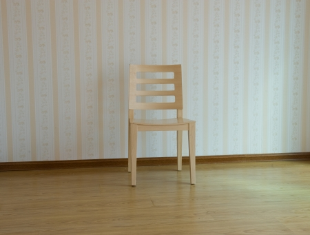 bright interior with wooden chair against wall  photo