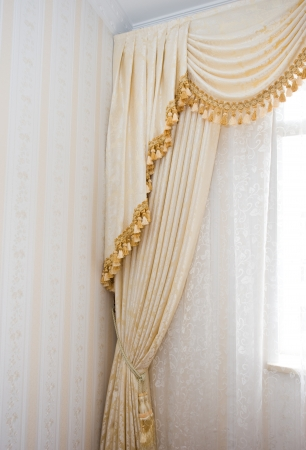 luxurious interior: curtain detail in a modern interior. Stock Photo