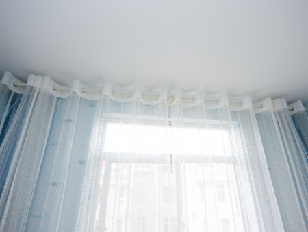 white velvet curtains in a room . Stock Photo - 14074604