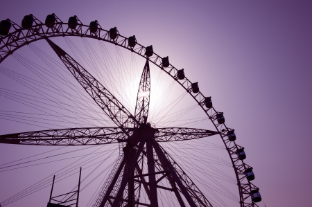 acrophobia: Silhouette of a ferris wheel at sunset  Stock Photo