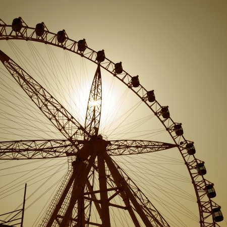 Silhouette of a ferris wheel at sunset  photo