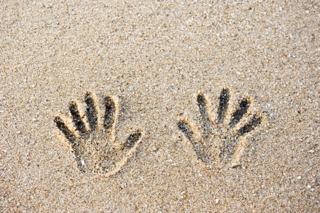 sand drawing: hand prints on the sand