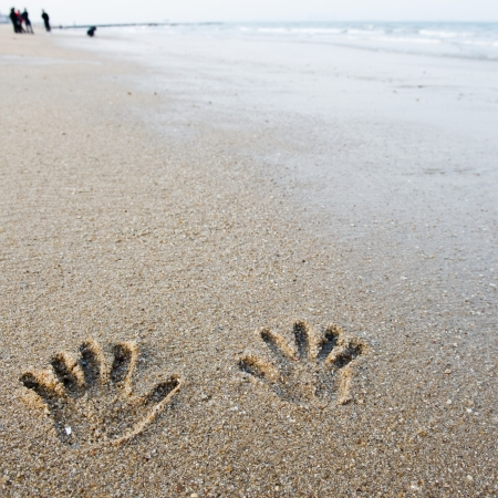 hand prints on the sand  photo