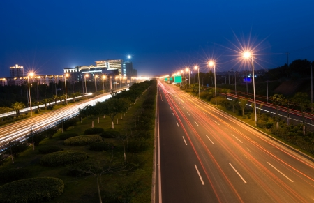 streetlight: The light trails on the modern building background in urban city of China.
