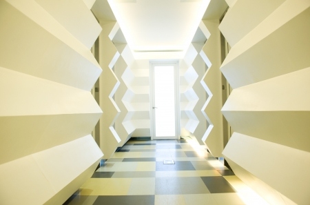 empty long corridor in the modern office building.  photo