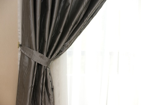 draped: beautiful curtain on edge of a window